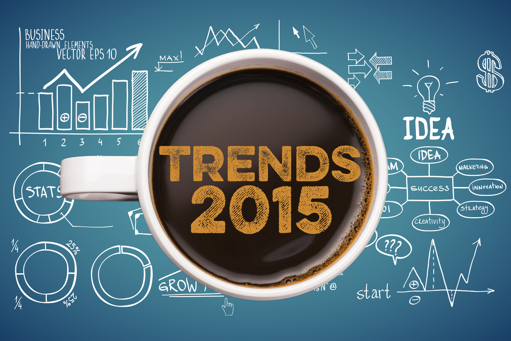 Image of a coffee mug over top of a blueprint with the words Trends 2015