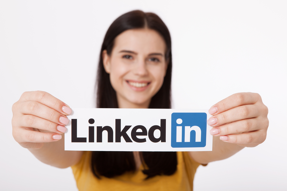 Holding up LinkedIn sign